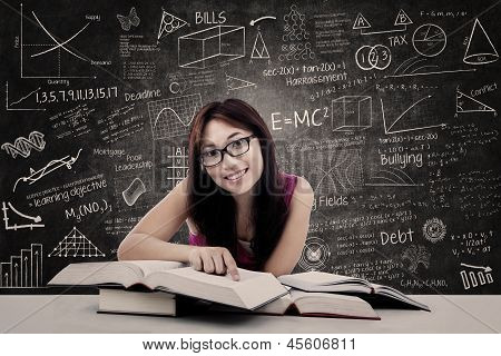Happy Student And Written Blackboard
