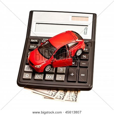 Toy Car And Calculator Over White. Concept For Buying, Renting, Insurance, Fuel, Service And Repair