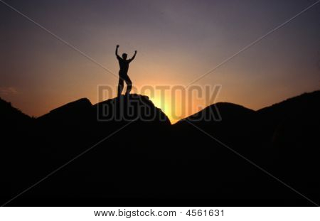 Man Raising His Hands With Success