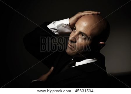 Attractive bald Arabic man wearing formal black suit, festive dresscode, mens fashion, executive manager