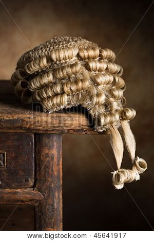 Real horsehair lawyer's wig on an antique wooden desk