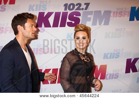 LOS ANGELES - MAY 11:  Ryan Seacrest, Demi Lovato attend the 2013 Wango Tango concert produced by KIIS-FM at the Home Depot Center on May 11, 2013 in Carson, CA