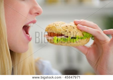 Closeup On Teenager Girl Eating Burger