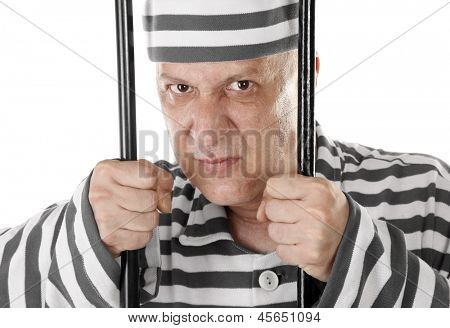 Angry convict prisoner jailbird behind bars