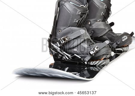 Snowboard with boots  on white background