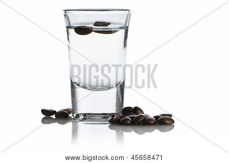 Sambuca in a shot glass surrounded by coffee beans, isolated on white background poster