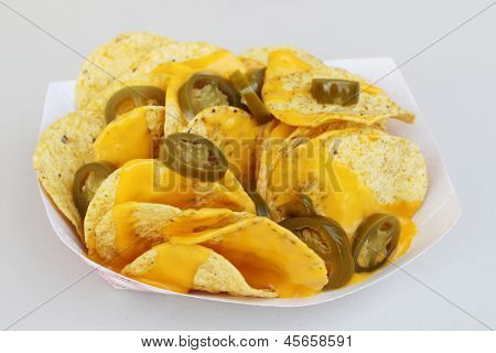 Nacho chips, cheese and peppers
