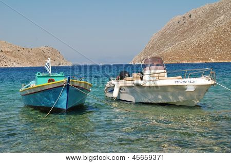 SYMI, GREECE - JUNE 25: Small boats moored in Pedi harbour on June 25, 2011 on the Greek island of Symi. Pedi is the old port of Symi with most traffic now going to the much larger harbour at Yialos.