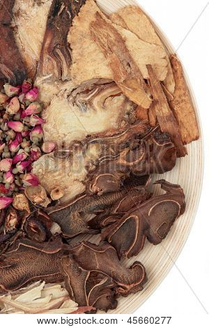 Chinese traditional herbal medicine selection on a wooden bowl over white background. poster