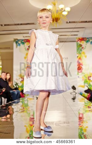 MOSCOW - MAR 17: Girl model in white gown at podium of Children Gallery Yakimanka during 5th Yakimanka Kids Fashion Week, March 17, 2012, Moscow, Russia.