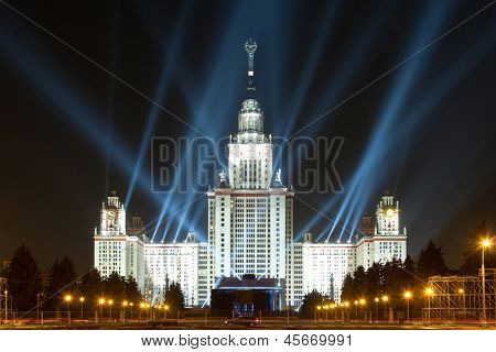 MOSCOW - AUG 28: Evening view of Moscow State University with large number of projectors, Aug 28 2011, Moscow Russia. Central building of university complex of Moscow State University on Sparrow Hills