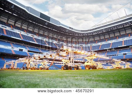 MADRID - MARCH 8: Lighting system for growing grass  in Santiago Bernabeu stadium, March 8, 2012 in Madrid, Spain. Stadium was built in 1947, is named after mud Real Madrid president Santiago Bernabeu