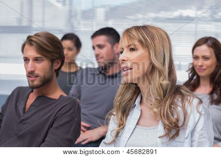 Patients listening in group therapy sitting in chairs