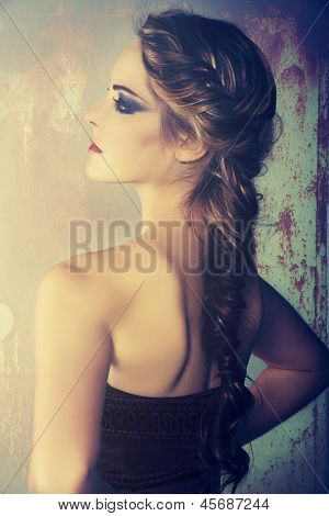 beautiful young woman with blond red hair in fishtail braid and dramatic eye makeup poster