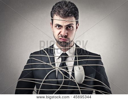 bored businessman tied with wire mouse