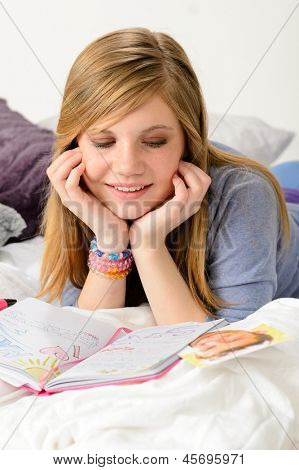 Friendly girl fantasizing over her diary about first love