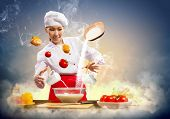 Asian female cooking with magic against color background poster