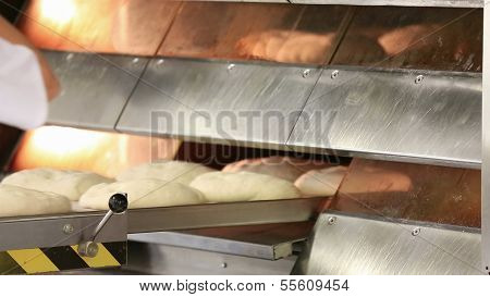poster of Working in a bakery, rustic bread to oven