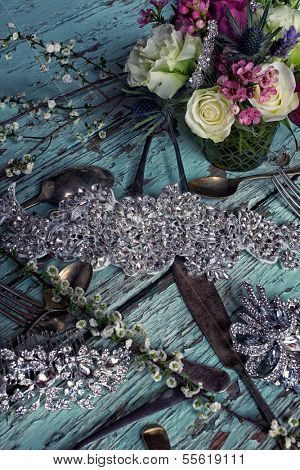 Fresh roses and white flower bouquets in romantic style on grunge table with bridal jewelry