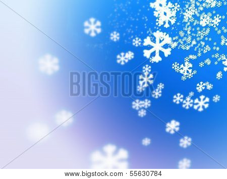falling snowflakes on a white-fading blue background