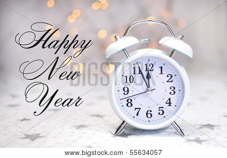 Happy New Year Message With White Retro Clock Showing Five To Midnight On White Starry Background Wi