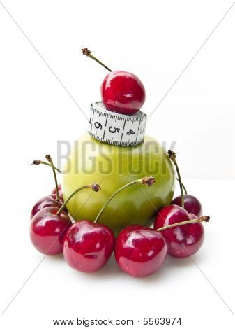 Apple With Cherries And Tape Measure