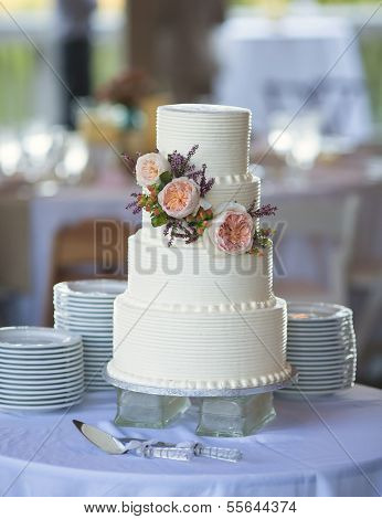 three tiered wedding cake with flowers