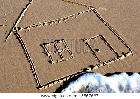 Picture Of A Housse Drawn In The Sand