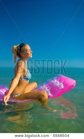 Pretty Blonde On Inflatable Raft