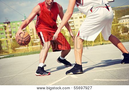 Two amateur basketball players on the court poster