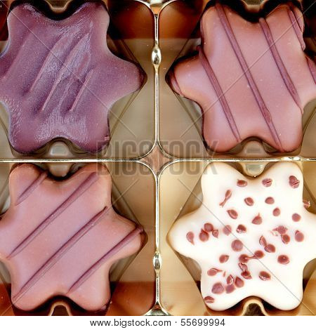 Delicious chocolate star-shaped with different types of chocolate