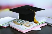 Money for graduation or training on wooden table close-up poster