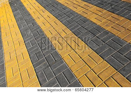 Pedestrian crossing road marking. Yellow rectangles on cobblestone road poster