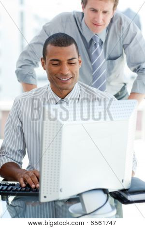Afro-american Businessman Working At A Computer