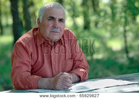 Thoughtful Senior Man Looking At The Camera