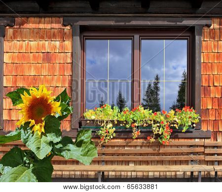 Picturesque popular cafe window with flower pots. Dachstein huge tourist complex in Austrian Alps poster