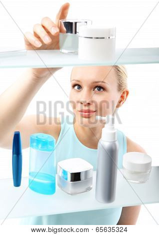 Woman in shop chooses cosmetics .