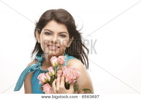 asian girl with bunch of pink roses