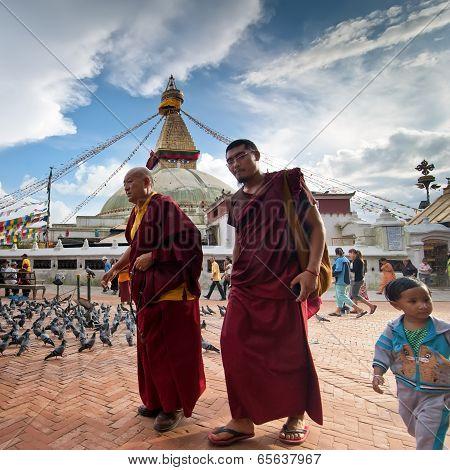 Buddhits Monks, Unidentified Child, Tourists And Pilgrims At Kora around Boudhanath Stupa. Nepal