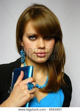 Brown-haired Woman With A Blue Brilliant