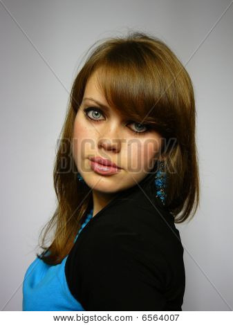 Brown-haired Woman With Blue Ornam
