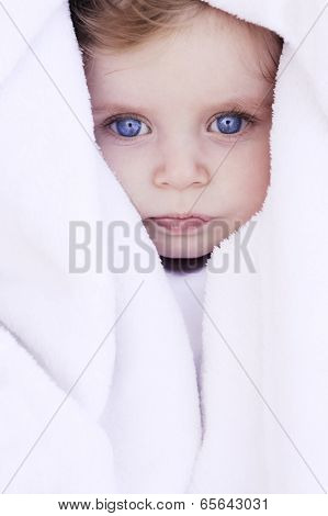 beautiful baby portrait with blanket