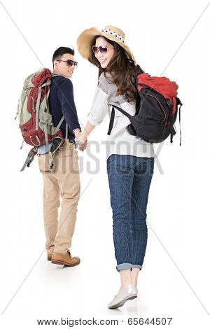 Asian young traveling couple, man holding woman's hand and lead her go to somewhere, full length portrait isolated on white background.