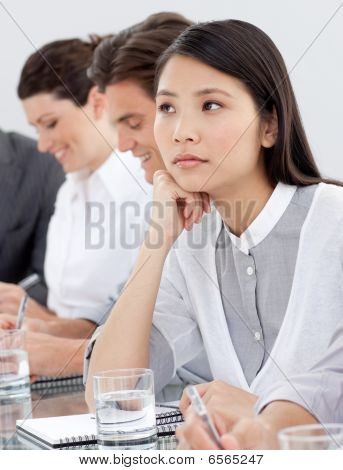 Asian Businesswoman Bored At A Presentation