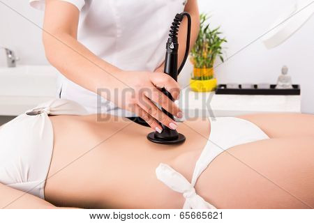 Woman getting anticellulite and anti fat therapy in beauty salon poster
