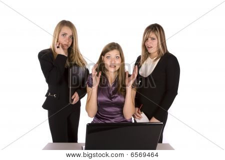 Three Frustrated Women With Computer