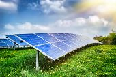 Landscape with solar energy field at summer day poster