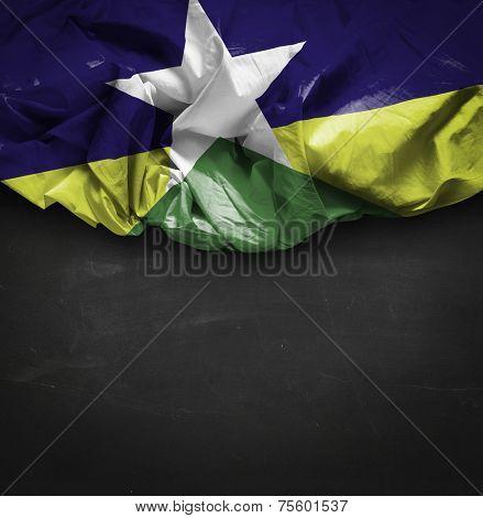 Rondonia, Brazil waving flag on blackboard