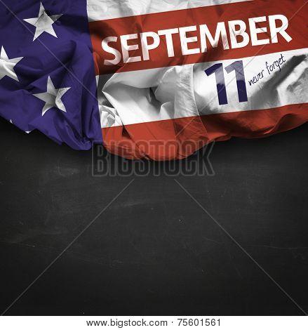 9/11 Patriot Day, September 11 waving flag on blackboard background