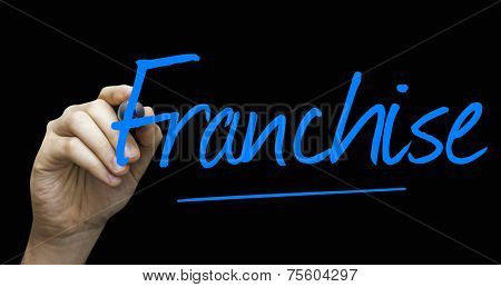 Franchise hand writing with a blue mark on a transparent board